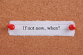If not now when typed on a paper note and pinned to a cork notice board Royalty Free Stock Image