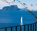 Ifach penon view of calpe in alicante and sailboat from moraira mediterranean at spain Royalty Free Stock Image