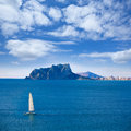 Ifach penon view of calpe in alicante and sailboat from moraira mediterranean at spain Stock Photography