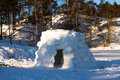 Igloo house in the winter on the lake constructed by hands for spending night Royalty Free Stock Photo
