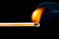 Igniting match with smoke black background Royalty Free Stock Images