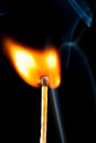 Igniting match with smoke black background Royalty Free Stock Photography