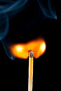 Igniting match with smoke black background Royalty Free Stock Photo