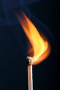 Ignition of a matchstick with smoke Royalty Free Stock Image