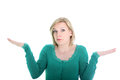Ignorant woman shrugging her shoulders Royalty Free Stock Images