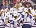 Iihf women s ice hockey world championship gold medal match canada v usa members of team touch the womens trophy after defeating Stock Photography