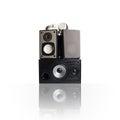 Iimage of three audio speakers and headphones, isolated on white. Royalty Free Stock Photo