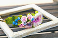 Ikebana. Flowers in a wooden frame. Royalty Free Stock Photo