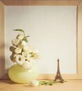 Ikebana and vintage photo-frame on table Royalty Free Stock Photo