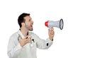 Il giovane dottore maschio shouting through megaphone Fotografia Stock
