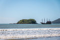 Ilha das Cabras Island and Touristic Pirate Ship - Balneario Camboriu, Santa Catarina, Brazil Royalty Free Stock Photo