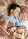 Ill child in bed Royalty Free Stock Photos