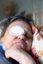 Ill person with eye bandage Royalty Free Stock Photo