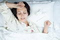 Ill Woman in Bed Royalty Free Stock Image