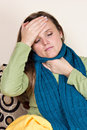 Ill woman at home having flu sitting on sofa couch Royalty Free Stock Photography