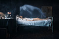 Photo : Ill woman lying in hospital bed, soul leaves body  of on