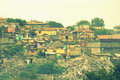 Illegal dump sight in shanty town maksuda huts shacks and tons of discarded junk around the gypsy ghetto rainy day varna bulgaria Royalty Free Stock Photo
