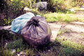 Illegal dumping in the nature garbage bags left in the nature toned image Stock Image