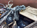 stock image of  Illegal Dumping, Trash in a Dumpster Collected During a River Cleanup