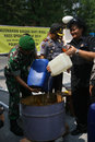 Illegal liquor police destroy in the city of solo central java indonesia Stock Image