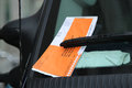 Illegal parking violation citation on car windshield in new york march Stock Image