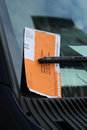 Illegal parking violation citation on car windshield in new york march Stock Photos