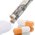 Illegal pharmaceutical pills and drugs on mirror money addiction objects Stock Image