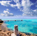 Illeta wooden pier turquoise sea Formentera Stock Photo