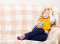 Illness child with cup on sofa Royalty Free Stock Photos