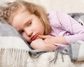 Illness girl wrapped child little in a blanket Stock Photography