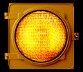 Illuminated amber traffic light Stock Photos