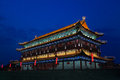 The illuminated ancient drum towe tower located at city wall by night time xian shanxi province china Royalty Free Stock Photography
