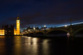 Illuminated big ben and westminster bridge Stock Image