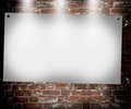 Illuminated blank banner in the background of an old brick wall Stock Photography