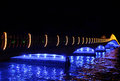 Illuminated bridge over river at night scenic view of colorful reflecting on Royalty Free Stock Photo