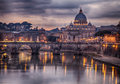 Illuminated bridge in rome italy saint peters basilica the background Stock Photography