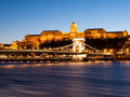 Illuminated Buda Castle and Chain Bridge over Danube River in Budapest by night, Hungary Royalty Free Stock Photo