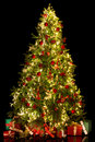 Illuminated christmas tree black background with a shiny isolated Royalty Free Stock Image