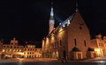 Illuminated city hall at night old town of tallinn estonia Stock Image