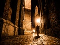 Illuminated cobbled street in old city by night Royalty Free Stock Photo