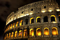 Illuminated Coliseum at night, Rome Stock Photography