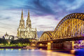 Illuminated dom in cologne with bridge and rhine at sunset Stock Image