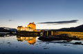Illuminated eilean donan castle the iconic scottish at dusk Royalty Free Stock Image
