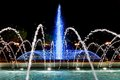 Illuminated fountain blue in the night Royalty Free Stock Photos