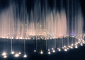 Illuminated fountain night urban scene by pink and purple light in a park in moscow russia by evening or with streetlamps Stock Images
