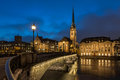 Illuminated fraumunster church and river limmat in zurich switzerland Stock Photography