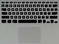 Illuminated keyboard top view of on modern laptop computer Stock Photos