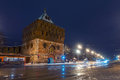 Illuminated kremlin wall and main gate in nizhny novgorod russia winter with white snow everywhere at night car traffic Royalty Free Stock Image