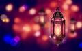 Illuminated lamp on Ramadan Kareem background