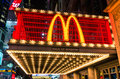 Illuminated mc donalds neon sign new york november with the world famous m representing mcdonalds along nd street in times square Stock Images